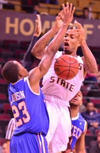 Texas State junior forward Joel Wright can't keep possession as he's defended by Louisiana Tech guard Jaron Johnson (Daily Record Photo by Gerald Castillo).