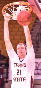Texas State senior forward Matt Staff throws down a dunk in Thursday night's loss (Photo by Gerald Castillo).
