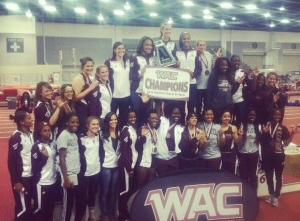 Members of the Texas State women's indoor track and field team pose with the trophy (Photo courtesy of Twitter).
