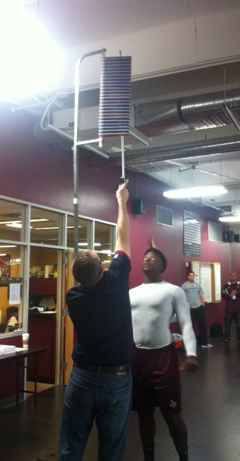 Former Texas State linebacker Joplo Bartu sizes up the vertical jump (Photo by Tyler Mayforth).