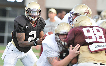 Texas State quarterback Jordan Moore looks for running room during Saturday's scrimmage (Photo by Gerald Castillo).