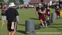 Senior quarterback Tyler Arndt works through an agility and ball-carrying drill Wednesday afternoon.