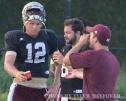 Senior quarterback Tyler Arndt gets a drink of water between reps at practice.