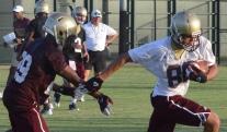 Freshman wide receiver Brice Gunter breaks away from freshman defensive back Brandon McDowell (Photo by Tyler Mayforth)