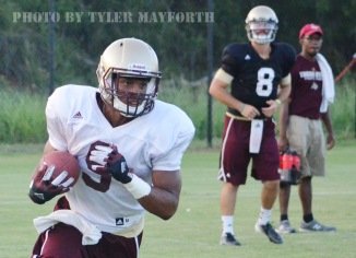 JUCO transfer running back C.J. Best cuts upfield during Thursday's practice.