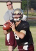 Senior quarterback Duke DeLancellotti rolls out for a pass during a recent practice.