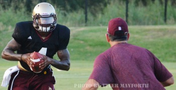 Texas State redshirt freshman quarterback Jordan Moore runs the option during a recent practice.
