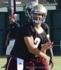 Freshman quarterback Tyler Jones follows through on a pass during a recent practice.
