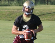 Texas State freshman quarterback Tyler Jones runs the option during fall camp.