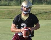 Texas State freshman quarterback Tyler Jones runs the option during fall camp.