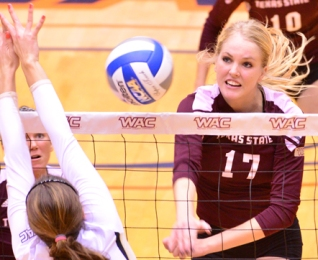 Texas State's Molly Aherns slams home a kill last year.