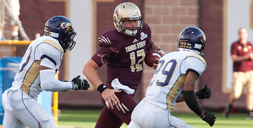 Texas State quarterback Tyler Arndt runs for a first down (Photo by Don Anders).