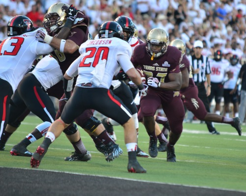 Texas State sophomore running back Tim Gay tries to find room around the goal line.