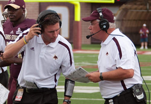 Texas State head coach Dennis Franchione speaks with an assistant during last week's game.