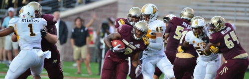 Texas State's Robert Lowe charges through a massive hole created by his offensive line.