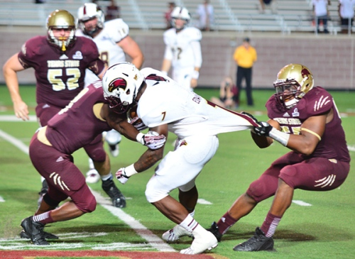 Texas State junior defensive end Michael O'Diari (right) and senior safety Justin Iwuji (left) combine on a tackle in last Saturday's game.