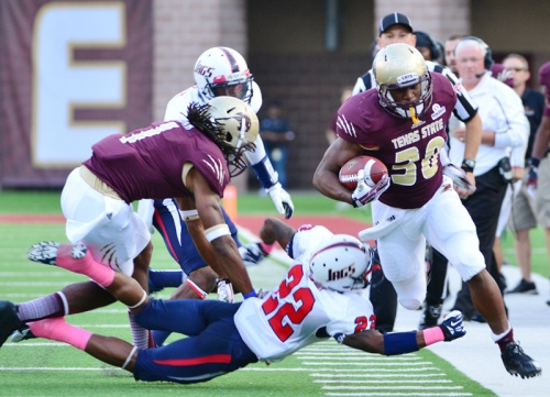 Texas State sophomore running back Chris Nutall charges up the sideline against South Alabama.