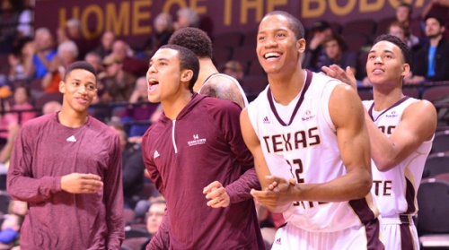 Players on Texas State's bench celebrate a moment in a recent game.
