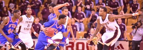 Texas State's Wesley Davis and Joel Wright defend the perimeter during Saturday's game with UT Arlington.
